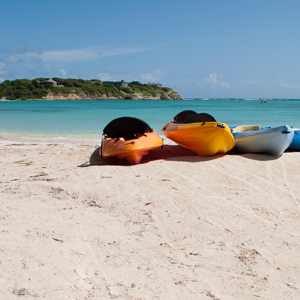 Stock image of kayaks on a beautiful beach