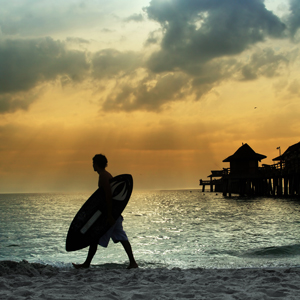 Stock image of surfer on the beach