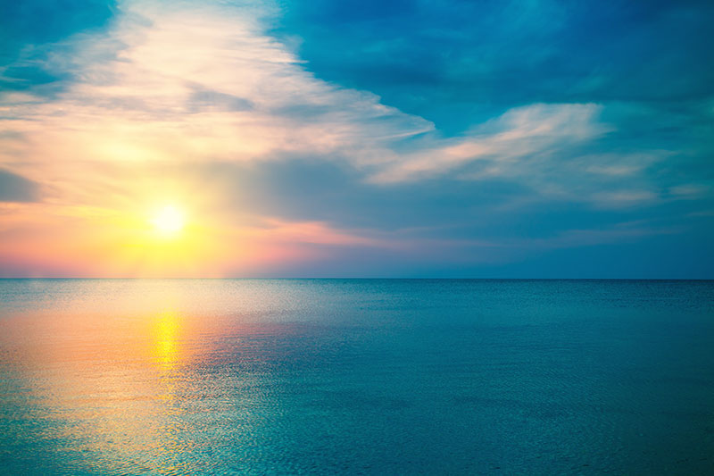 stock nature photo of sunset on the ocean