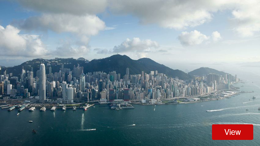 Aerial view of boats and skyline on Hong Kong coast