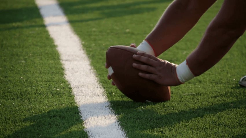 Stock Footage of a Football Being Hiked