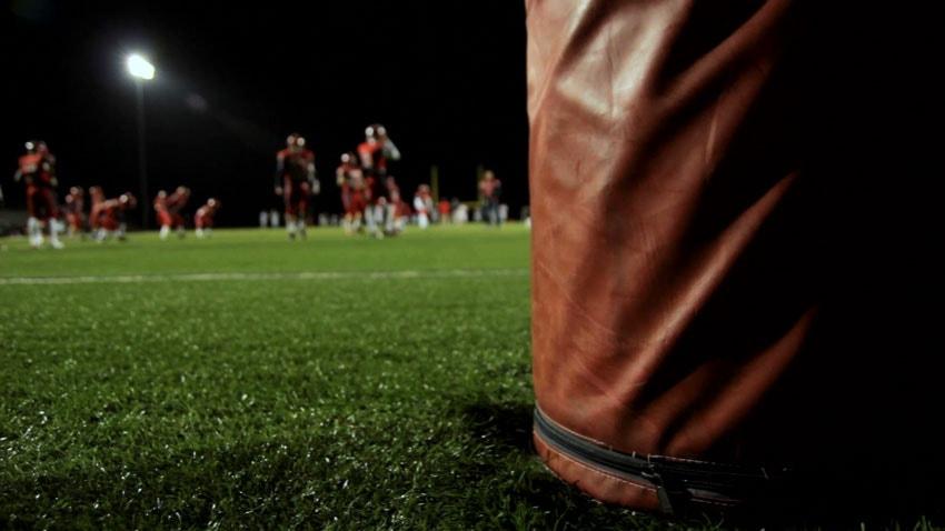 Panning shot of football players