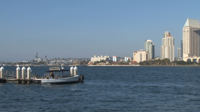 Water Taxi in San Diego Harbor Skyline across Waterfront  Stock Photo