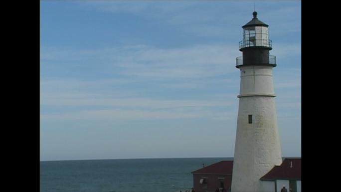 White Lighthouse and Ocean Horizon Stock Photo