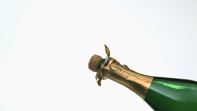 Slow Motion Champagne Bottle Pop Stock Photo