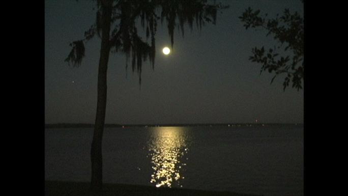 Moon Reflection on Lake Stock Photo