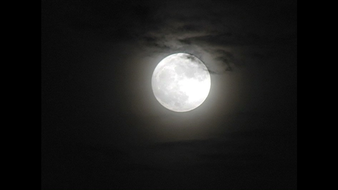 Clouds Drifting Over White Moon Stock Photo