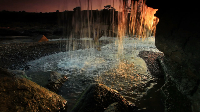 Inside Shot of a Waterfall at Sunset Stock Photo