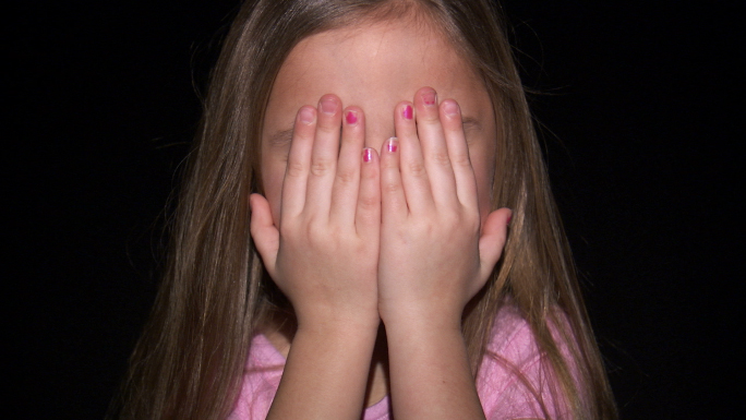 Little Girl Playing Peek-a-Boo 2 Stock Photo