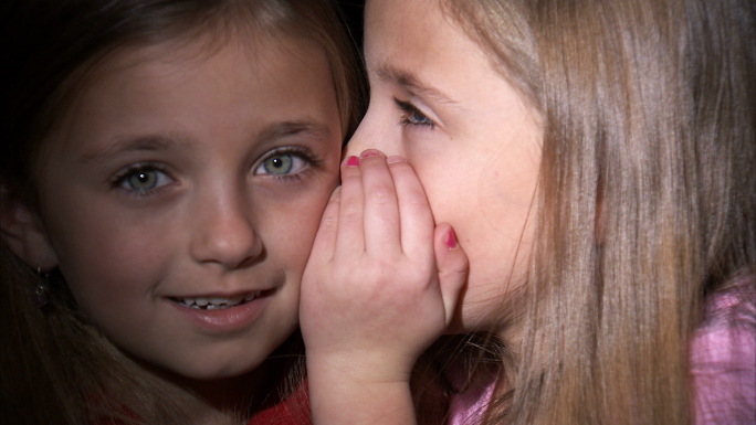 8 Year Old Twins Whispering Stock Photo