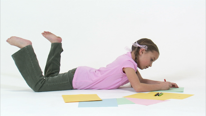 Little Girl on Stomach Drawing with Crayons 2 Stock Photo