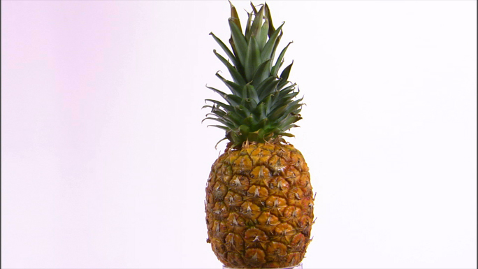 Pineapple with Cut Out Wedge Rotating Stock Photo