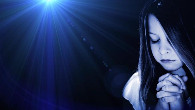 Girl Praying Blue Flare Stock Photo