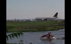 People Jetskiing Near Airport