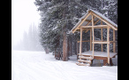 Wooden Structure in Snowstorm in Colorado Forest