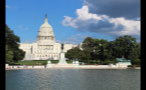Sun Shining on US Capitol Building and Reflecting Pool in Washington DC