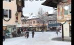 Woman Walking Bike Across Snow Covered Street in Germany