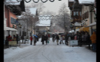 Crowded and Snowy Street in Small German Town