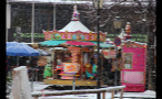 Carousel in the Snow at German Town Market