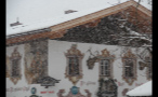 Snowing on Decorated Building in German Town