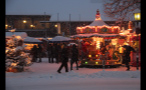 Snow Covering German Town Marketplace With Carousel