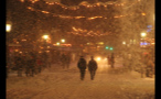 People Walking Down Main Road in German Town During Blizzard