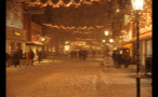 Snow Covering Street in German Town at Night
