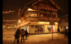 Lights on Building in German Town at Night Time