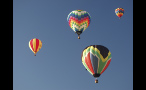 Several Hot Air Balloons in the Sky Above