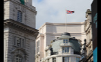 British Flag Waving on Rooftop in Piccadilly Circus