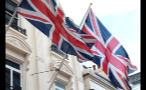 Close Up of Two British Flags Waving on Buildings