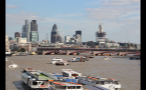 Boats on River Thames and London Cityscape