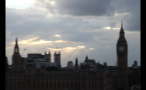 Sun Bursting Through Clouds Over Palace of Westminster
