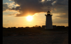 Sun in Orange Sky Behind Edgartown Lighthouse in Marthas Vineyard