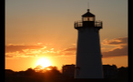 Orange Sky at Sunset and Lighthouse on Marthas Vineyard