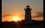 Lighthouse on Marthas Vineyard With Orange Sky at Sunset