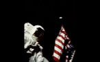 Astronaut With American Flag and Earth in the Distance