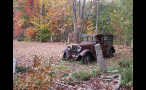 Old Car in Field in Autumn