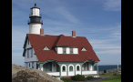 Red Roof House in Front of Portland Head Lighthouse