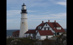 Red Roof House in Front of Portland Head Lighthouse in Maine