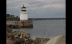 Small White Lighthouse in New England on the Water