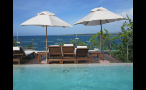 Lounge Chairs and Umbrellas on Pool Deck