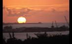 Huge Sun Setting on Horizon