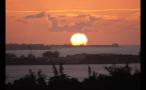 Big Sun Setting on Horizon
