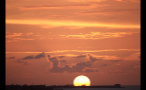 Yellow and Orange Sky During Island Sunset