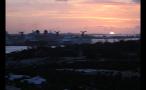 Cruise Ships and Island Landscape at Sunset