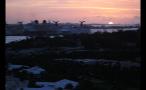 Island Landscape and Cruise Ships at Sunset