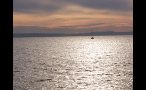 Boat in Puget Sound at Sunset
