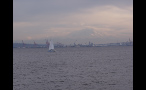 Sailboat in Puget Sound With Mountains in the Distance