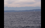 Mountains and Sailboat in Puget Sound in Seattle